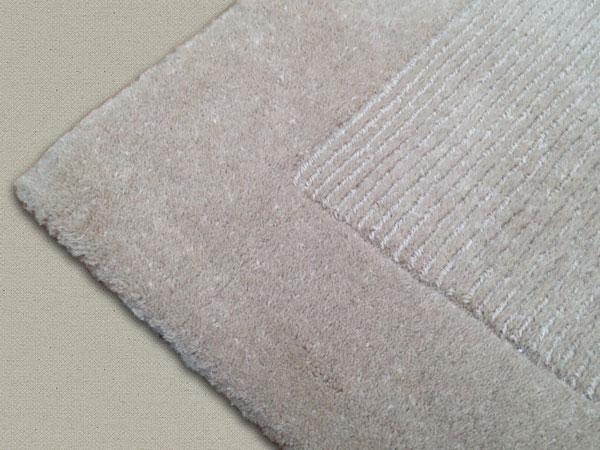 Bordure rapportée sur tapis rétréci