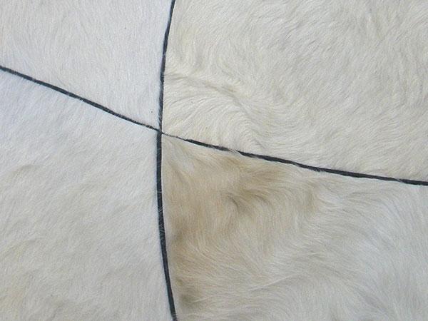 Création d'un tapis en cuir de vachette